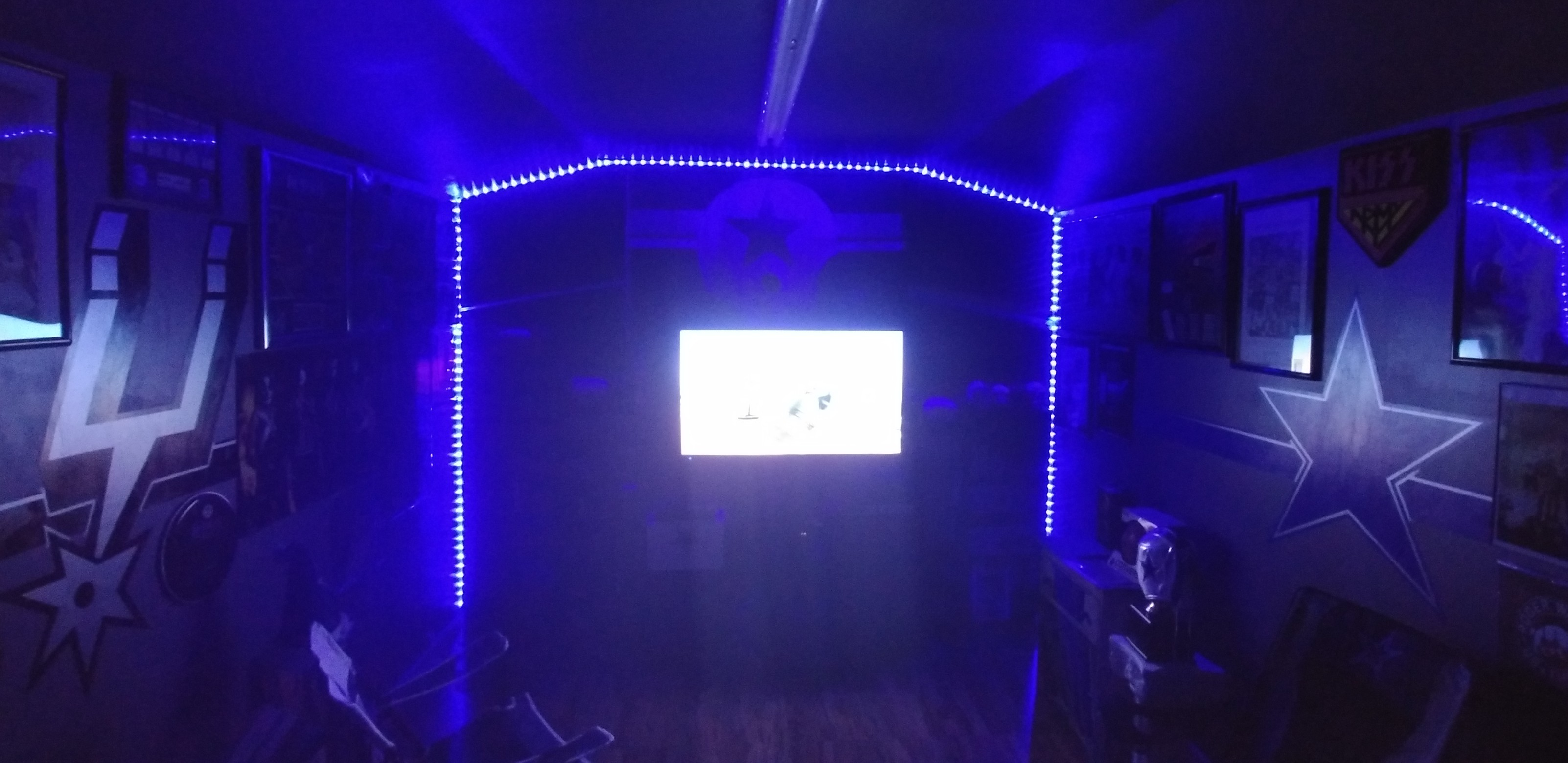 Added some lighting to the cave. It's a little messy, the tv actually looks better than the pi