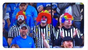 https://www.totalprosports.com/2019/10/20/lions-fans-showed-up-to-game-dressed-as-clown-refs-pics/ S